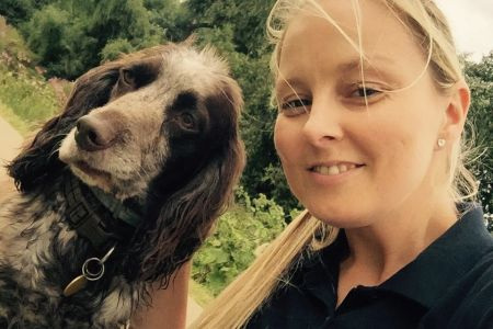 Four Legged Friends Petcare - Kelly with a happy dog.jpg