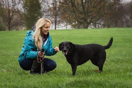 Four Legged Friends Petcare - Kelly with happy dog.jpg
