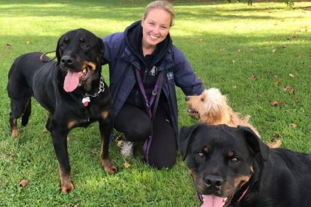 Four Legged Friends Petcare - Kelly with happy rottweilers.jpg